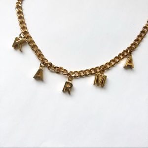 gold karma necklace